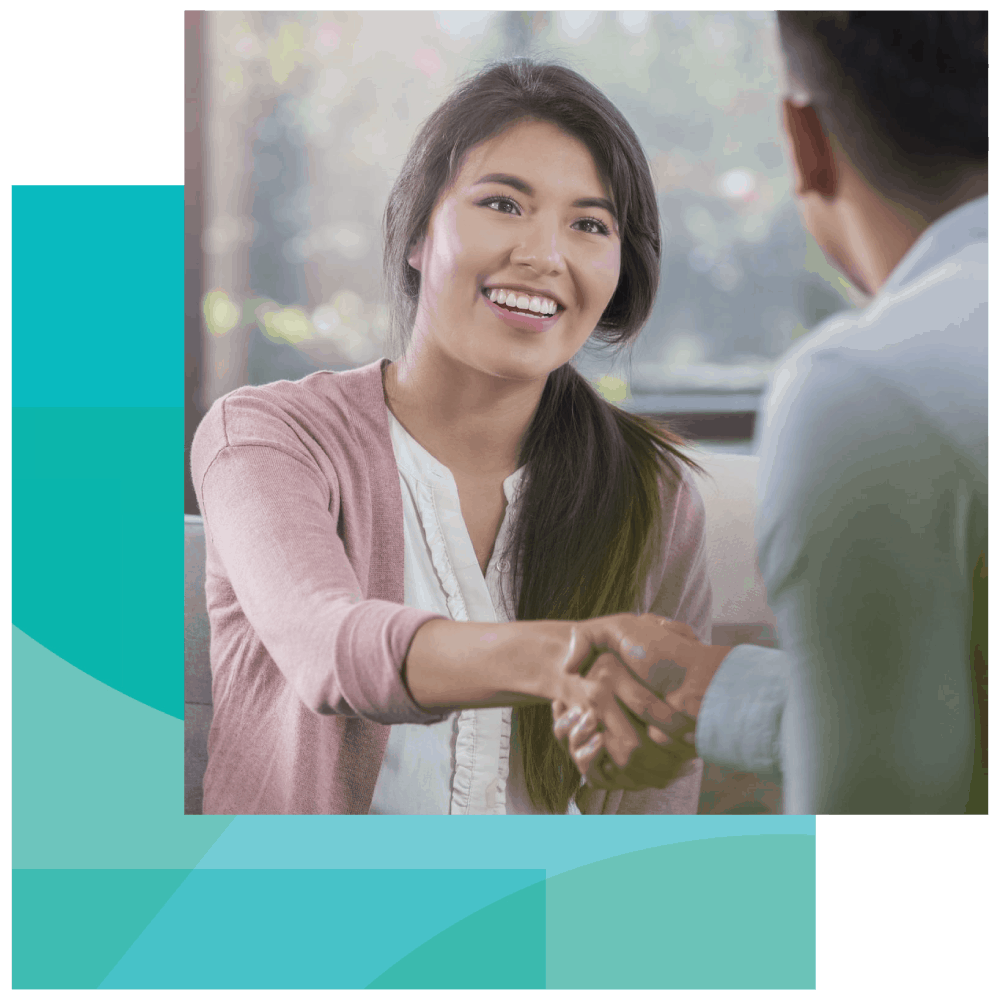 An EAP counselor shakes hands with a BALANCE financial coach trainer