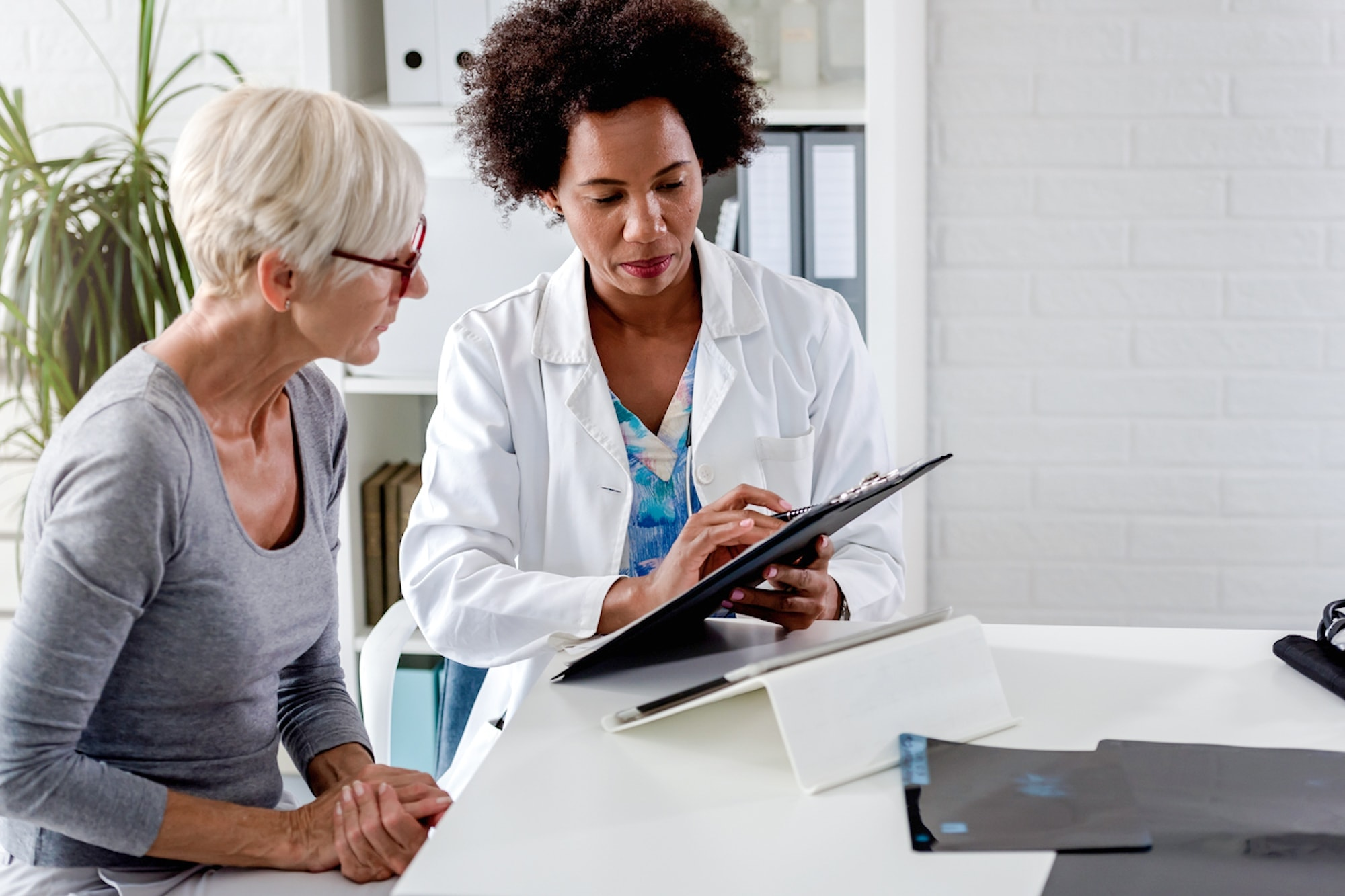 A healthcare professional discusses plans and options to a patient